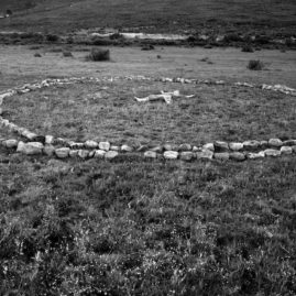 Rock circle on a grass veld - land art by Annie le Roux